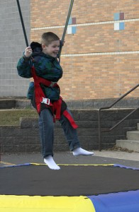 Jacob Taylor bounces Thursday at Sibley Elementary School. Children at the school who raised $75 or more for the walkathon got to bungee bounce as a prize. There were a total of 164 children who raised $75 or more. -- Kelli Lageson/Albert Lea Tribune