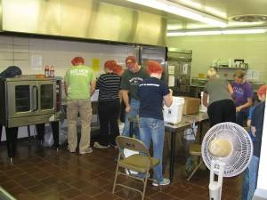 Volunteers work to make many pies at Hollandale Christian School.