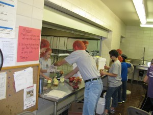 Students are among the helpers making pies for a fundraiser at Hollandale Christian School.