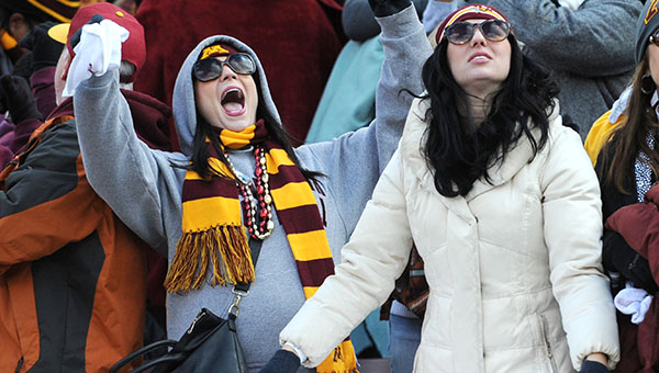 Minnesota fans celebrate after Philip Nelson gave the Gophers a two-possession cushion with 48 seconds left Saturday against Nebraska. Minnesota won 34-23. -- Micah Bader/Albert Lea Tribune