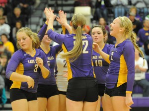 The Lake Mills volleyball team celebrates after a point in Tuesday's Class 2A, Region 1 volleyball match against St. Ansgar. — Drew Claussen/Albert Lea Tribune