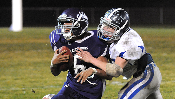 Mitchell Athey of Northwood-Kensett hits Kee's Marquis Phillips hard enough to jar both of their helmets loose in front of the Vikings sideline. Athey had 10 tackles for the Vikings and Northwood-Kensett won 36-22. — Micah Bader/Albert Lea Tribune