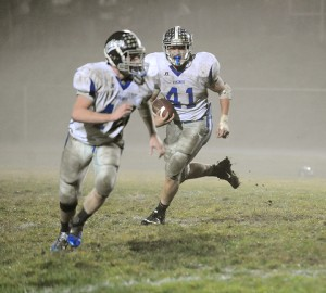 Brandon Brockman, right, carries the ball, while Mitchell Athey is the lead blocker on a run to the perimeter Wednesday at Kee during the first round of the Class 8-Man state playoffs. Fog and smoke from a bonfire made visibility low. — Micah Bader/Albert Lea Tribune