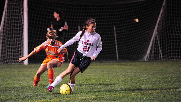 Rachel Rehnelt of Albert Lea dribbles the ball seconds before scoring a goal to give the Tigers a 2-1 lead in the second half Thursday against Winona. The Winhawks rallied in overtime to win 3-2. — Micah Bader/Albert Lea Tribune