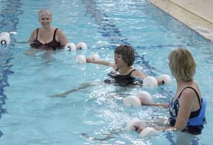 Marcia Sczublewski, middle, instructs a deep water aerobics class at the Albert Lea Family Y. -- Kelli Lageson/Albert Lea Tribune