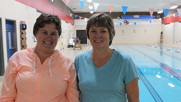 Jill Nelson, left, and Marcia Sczublewski are two of the instructors of the night deep water aerobics class at the Albert Lea Family Y. -- Kelli Lageson/Albert Lea Tribune