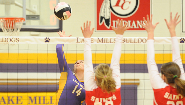 Lake Mills' Cede Byrnes attempts a spike during Tuesday's Class 2A, Region 1 volleyball match against St. Ansgar. — Drew Claussen/Albert Lea Tribune