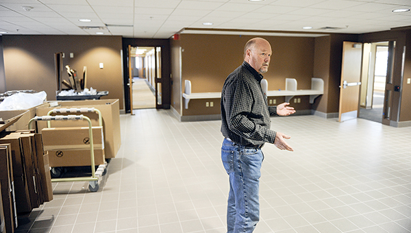 Mower County coordinator Craig Oscarson stands in the new lobby to the upstairs remodel of the Government Center during a tour of the area.  --Eric Johnson/Albert Lea Tribune