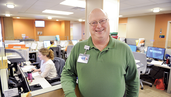 Dr. Greg Angstman stands in a commons area where a team of health care professionals work. Mayo Clinic Health System in Albert Lea and Austin is trying a new team care approach where doctors lead a team of health care workers to care for patients. -- Eric Johnson/Albert Lea Tribune
