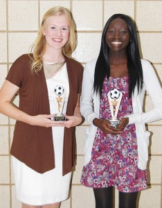Three players won the dynamic silver-level award from Albert Lea girls' soccer head coach Rick Barnhill at the awards banquet on Oct. 24. From left are Sarah Niebuhr and Becca Dup. Anna Anderson is not pictured. — Submitted