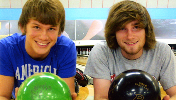 Parker Boyum, 15, left, bowled his second career 300 game in the Saturday 8:30 a.m. Pepsi Doubles League with teammate Christian Roche at Holiday Lanes. Boyum scored 746 in the series, and Roche scored 731 in the series. — Submitted