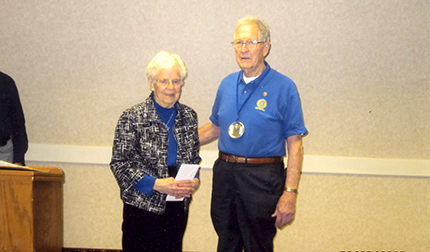 In 2012-13 the Rotary Club donated more than $2,000 to the Ecumenical Food Shelf. Receiving the check is Arlene Egerdal to help the program and Earl Jacobsen representing the Rotary.