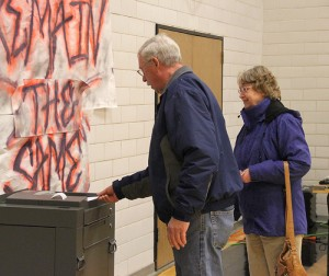 David and Liz Thunstedt submit their votes Tuesday at Alden-Conger School. Both said they voted yes for the operating levy and were glad to support the school district. -- Kelli Lageson/Albert Lea Tribune