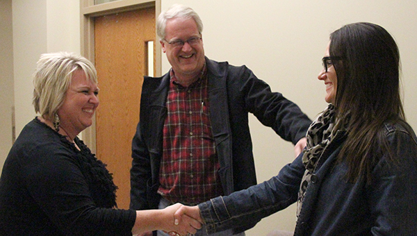 Albert Lea school board members from left Julie Johnson, Bill Leland and Linda Laurie congratulate each other at the Freeborn County Courthouse Tuesday evening after finding out the Albert Lea School District's operating levy renewal passed. -- Kelli Lageson/Albert Lea Tribune