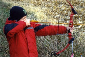 Ethan Ball aims a hunting bow at a 3-D target supplied by the Full Draw Archery Club during an event sanctioned by the Minnesota Deer Hunter's Association on Oct. 19. Archery was one of several learning stations for the kids. — Submitted