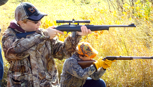 Brock Hammer, left, and Jake Ball shoot at targets with .22-caliber rifles during a five-hour event sanctioned by the Southern Gateway Chapter of the Minnesota Deer Hunter's Association on Oct. 19. Kids at the event also shot clay pigeons with .20- and .12-guage shotguns. — Submitted
