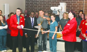Riverland officials and Austin Chamber of Commerce Ambassadors cut the ribbon for a new X-ray machine Thursday afternoon at Riverland Community College. -- Submitted