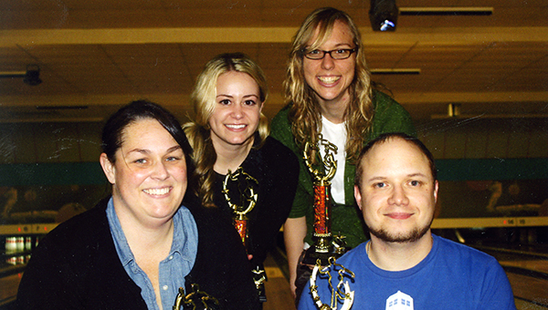 Back row from left are the winners of the Educator's Bowling League at Holiday Lanes: Kelsey Turnbull and Leah Mortensen. Front row from left are the second-place team in the league: Amanda Lester and Dustin Olson. Another eight-week session of the league will begin Jan. 9. — Submitted