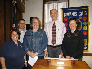 Albert Lea's Noon Kiwanis inducted new members Annette Petersen and John Holt. From left are sponsors Kim Nelson and Chad Adams, Petersen, Holt and former president, Angie Eggum. -- Submitted