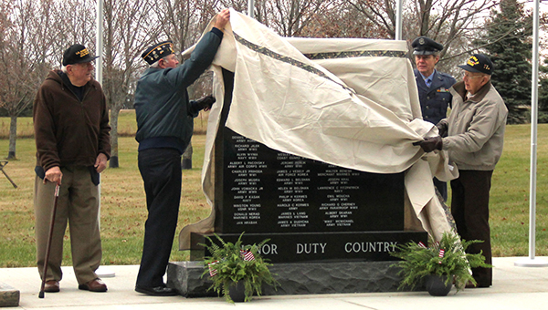 --Veterans unveil a new memorial at the Bohemian National Cemetery near Myrtle during a dedication ceremony Saturday. --Kelli Lageson/Albert Lea Tribune