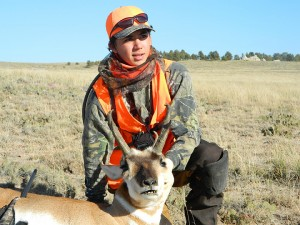 Karter Kenis looks into the distance in the Thunder Basin National Grassland near Bill, Wyo., after shooting a pronghorn antelope while hunting with his father and grandfather. — Submitted