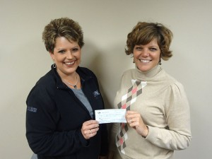 Nikki Schumacher, left, receives a check from the Noon Kiwanis former president, Rhonda Allison, for the Edgewater Youth Soccer Complex in Albert Lea.