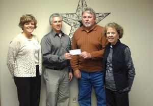Past President Rhonda Allison and Rick Mummert of the Noon Kiwanis present a donation to Don Goodnature and Deb Goodnature for the Corey Goodnature Scholarship Memorial Fund.