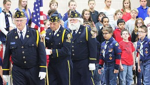 Members of the American Legion Leo Carey Post 56 carry the U.S. flag out of the Lakeview Elementary School gymnasium Monday at the close of a Veterans Day program. --Sarah Stultz/Albert Lea Tribune