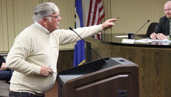 Albert Lea resident Ken Mulgrew talks with his hands while standing before the Albert Lea City Council on Tuesday. He is telling a story about skateboarders and bike riders trespassing on a private drive near the City Beach. -- Tim Engstrom/Albert Lea Tribune