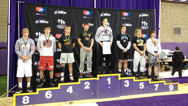 Colten Carlson, third from left, stands on the podium after taking fourth place at the USA preseason national wrestling tournament in Cedar Falls, Iowa. — Submitted