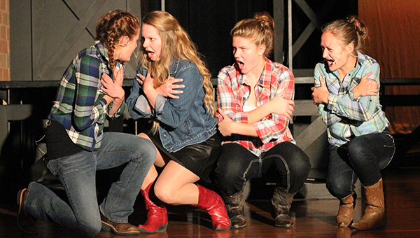 """Rusty, played by Krystal Thompson, Ariel, played by Rika Boorsma, Wendy Jo, played by Hanna DeVries, and Urleen, played by Emma Behling, sing """"Holding Out for a Hero,"""" during a rehearsal at Albert Lea High School on Tuesday. --Brandi Hagen/Albert Lea Tribune"""