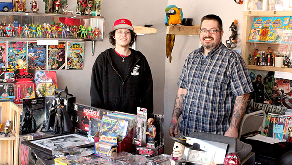 Casey Olson, left, and Gilbert Johnson Jr., stand at the counter in The Chapel Comics & Collectibles Shoppe on Friday. The shop opened on Oct. 31. -- Brandi Hagen/Albert Lea Tribune