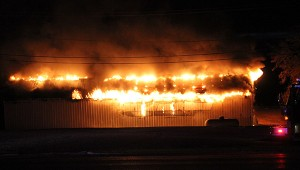 Fire engulfs a pole barn behind Subway on East Main Street at 6:30 a.m. Monday. — Tim Engstrom/Albert Lea Tribune
