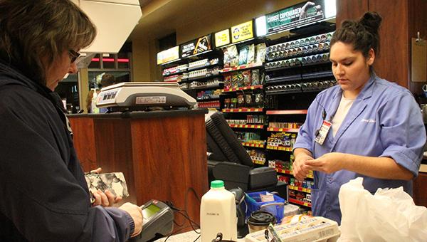 Kwik Trip employee Kaylinn Talamantes rings up the groceries of Bobbi Hobbie of Albert Lea this morning.  -- Sarah Stultz/Albert Lea Tribune