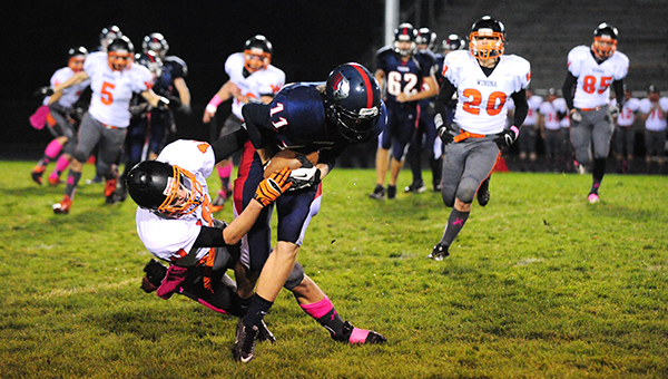 Chris Enderson of Albert Lea slips a tackle against Winona in the last game of the regular season. The Tigers also played the Winhawks in the first round of the Section 1AAAA playoffs. Albert Lea lost the first meeting 60-21 and the second meeting 47-12. Albert Lea hopes to improve next season on an 0-9 record. — Micah Bader/Albert Lea Tribune