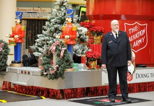Albert Lea Salvation Army Capt. Jim Brickson rings a bell near a large Salvation Army display inside of Northbridge Mall on Tuesday at the start of a world record attempt. -- Brandi Hagen/Albert Lea Tribune
