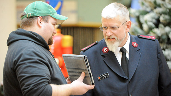 Capt. Jim Brickson of the Albert Lea Salvation Army Skypes with his son, Jeff, who is in the military and stationed in Virginia. Jeff was unable to be home for the world record attempt, but was able to see through the event through the web camera. -- Brandi Hagen/Albert Lea Tribune