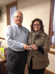 Albert Lea Daybreaker Kiwanis recently donated to the committee to save the Edgewater Cottage. Pictured is President-elect Catherine Buboltz presenting the donation to Bob Goldman, a member on the committee. -- Submitted