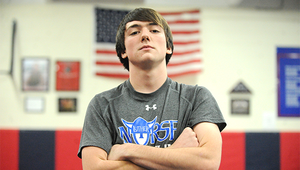 Bryce Hoyt of the Albert Lea wrestling team stands in the wrestling room Wednesday at Albert Lea High School. — Micah Bader/Albert Lea Tribune