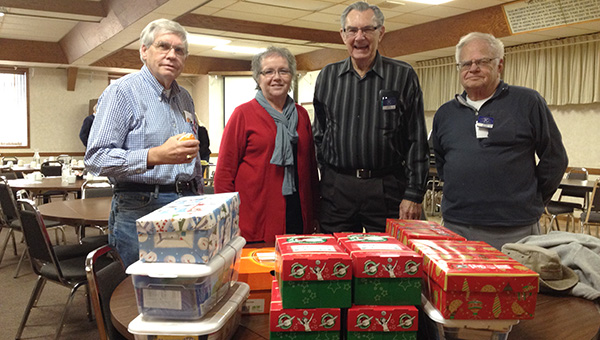 Members of the Albert Lea Daybreakers Kiwanis recently donated shoeboxes filled with gifts for children to Samaritan's Purse Operation Christmas Child. Pictured from left are Daybreakers Kiwanis members Darryl Meyer, Lois Ahern, Dick Polley and Kyle Olson. -- Submitted