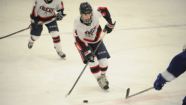 Matt Cheever of Albert Lea takes the puck up the ice Thursday during a 2-1 overtime loss to Owatonna in the Tigers' home opener. — Micah Bader/Albert Lea Tribune