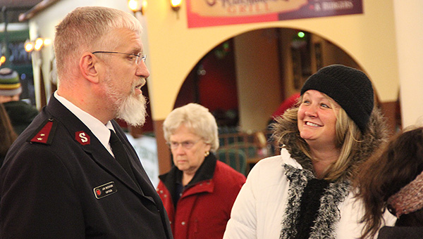 Albert Lea resident Trena Siefken, right, speaks with Capt. Jim Brickson at 8:30 p.m. Thursday at Northbridge Mall. Brickson remains on track to break the world record for ringing a Salvation Army bell. The 80-hour world record mark will be at 7 p.m. tonight. --Tim Engstrom/Albert Lea