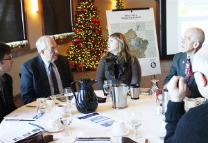 Laura Lunde, center, board member of the Lakes Foundation of Albert Lea, and Randy Kehr, right, executive director of the Albert Lea-Freeborn County Chamber of Commerce, talk with Senate Capital Investment Committee Chairman LeRoy Stumpf and other senators Thursday at Wedgewood Cove Golf Club.
