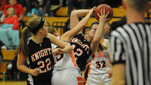 Brooke Reyerson of Alden-Conger gets fouled while shooting against Madelia. Reyerson scored eight points for the Knights.