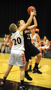Liesel Theusch of Alden-Conger drives to the basket Friday against Madelia. Theusch had a double-double with 17 points and 12 rebounds. — Micah Bader/Albert Lea Tribune
