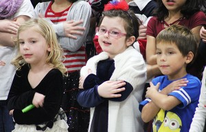 Students motion like they are giving a hug Friday during a concert at Lakeview Elementary. -- Sarah Stultz/Albert Lea Tribune