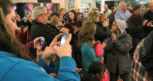 People take to social media with their cellphones Friday night at Northbridge Mall while others applaud after Salvation Army Capt. Jim Brickson breaks the world record for ringing a Salvation Army bell. -- Tim Engstrom/Albert Lea Tribune