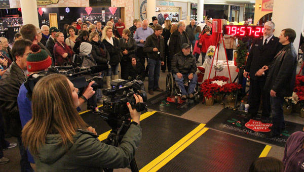 Members of the media and onlookers gather shortly before 7 p.m. at Northbridge Mall to watch Salvation Army Capt. Jim Brickson surpass the world record of 80 hours for ringing a Salvation Army bell.