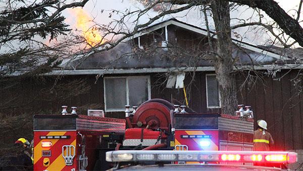 A home on Pickerel Lake burns Thursday morning. — Drew Claussen/Albert Lea Tribune