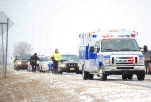 Emergency personnel respond to a fatal crash on Interstate 35 Jan. 30 four miles north of the Iowa border. --Brandi Hagen/Albert Lea Tribune
